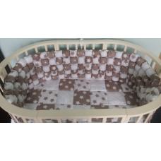 Комплект 8 предметов с бортиками из помпонов в овальную кроватку Арт. 125 (ОК)